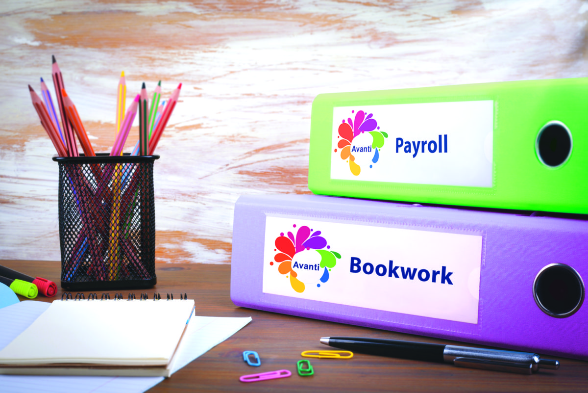 Payroll, Office Binder on Wooden Desk. On the table colored pencils, pen, notebook paper